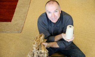 Naturally Advanced CEO, Ken Barker poses with hemp fibres.
