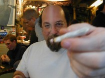 Man smoking a joint in an Amsterdam coffeeshop